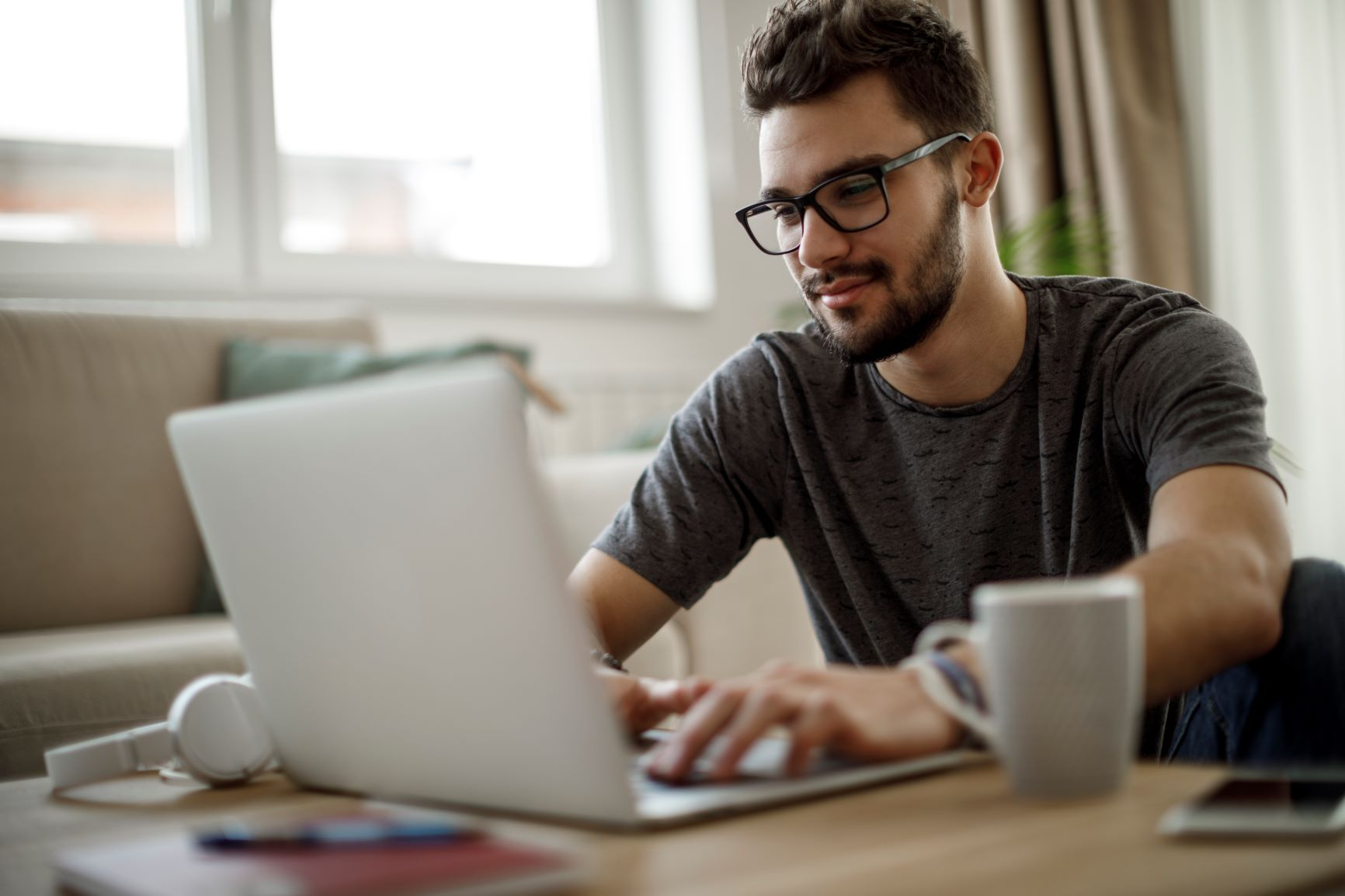 man-learning-on-laptop-at-home